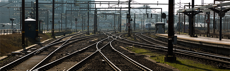Copenhagen, Denmark - February 23, 2014: Complex system of railway tracks before Copenhagen central station.Arriving trains in the background.